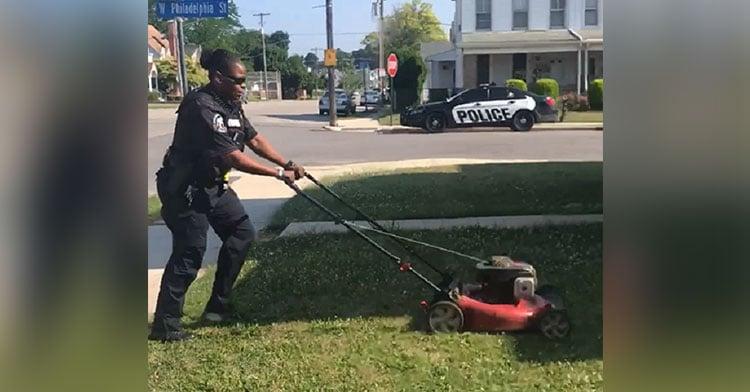 cop mowing lawn