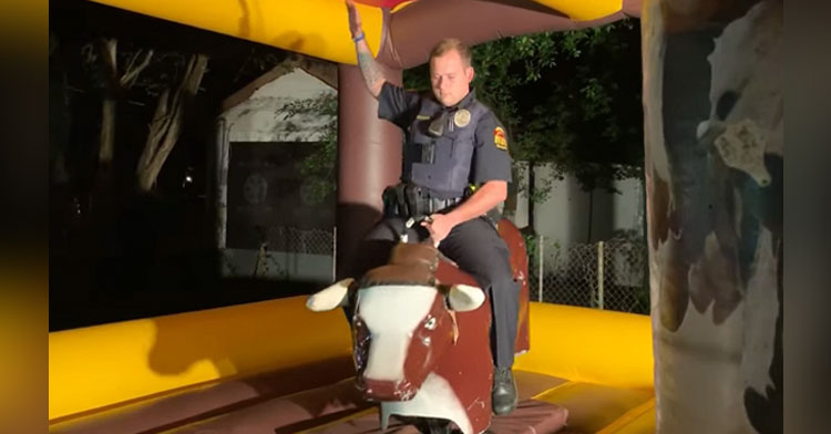cop rides mechanical bull