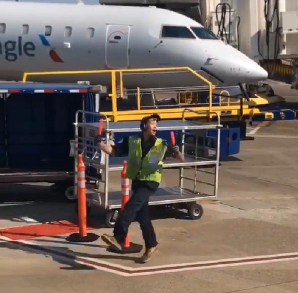 baggage claim handler dancing