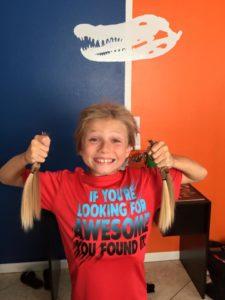 christian donates hair