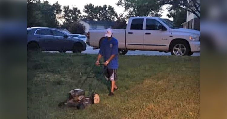 neighbor cuts grass