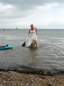 wedding dress paddleboarding