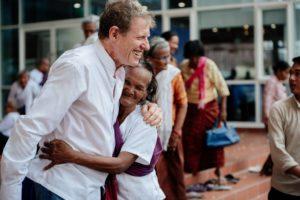 scott hugs cambodian woman