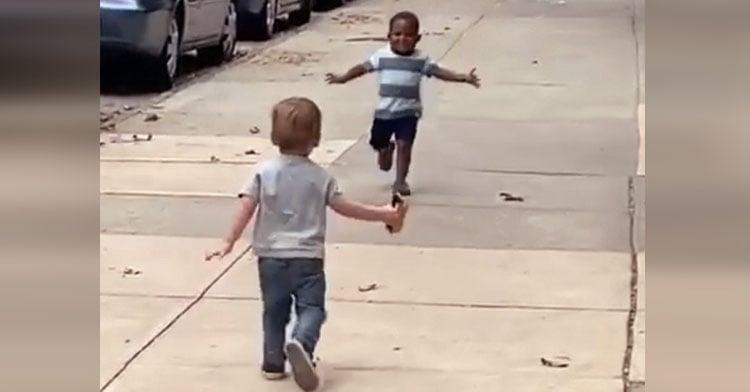 little boys running hug