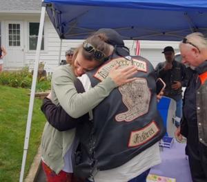 daryn hugs biker