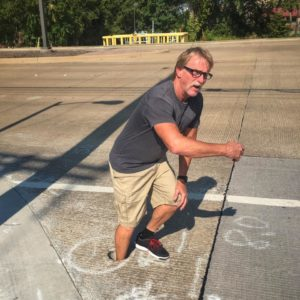 max stands in crosswalk hole