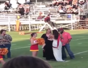 homecoming queen gives crown to friend