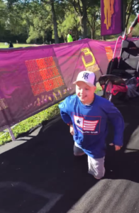 owen runs to finish line