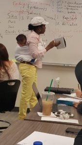 Professor Cissé holds baby