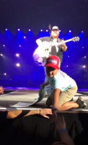 hudson gets high five on stage
