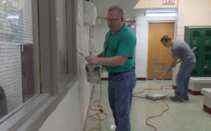 superintendent paints school