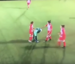 soccer players help opponent