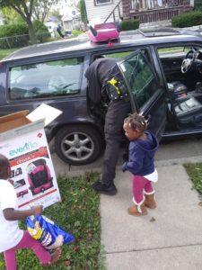 officer Zimmerman installs car seat