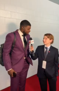 kid reporter interviews hockey player