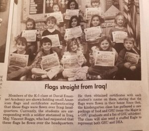 students hold up flags in newspaper