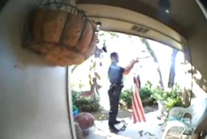 officer folds fallen flag