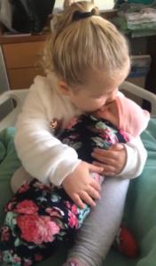 molly kisses baby sister