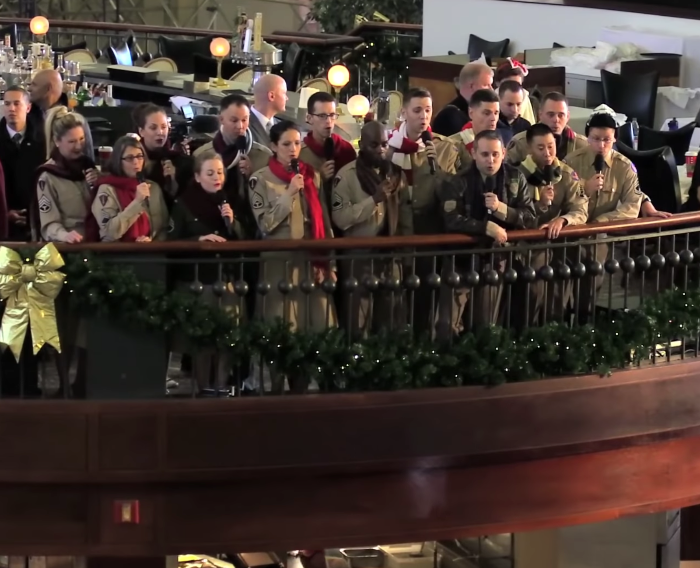 US Air Force Band Pulls Off Epic 1940s Holiday Performance In Crowded Train Station.