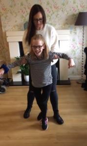 leonie helps tarli take steps