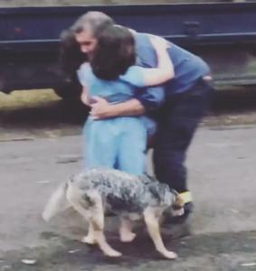 colin hugs daughters