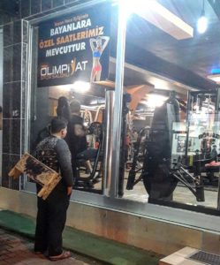 muhammad stands outside gym