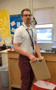 mr. payne opens gift