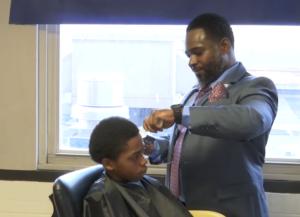 principal newton cuts hair