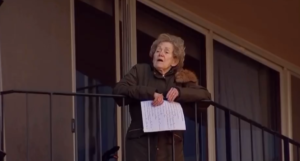 seniors sing from balconies