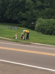 ray gives socks to homeless man