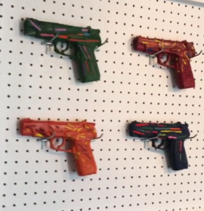 one gun art display