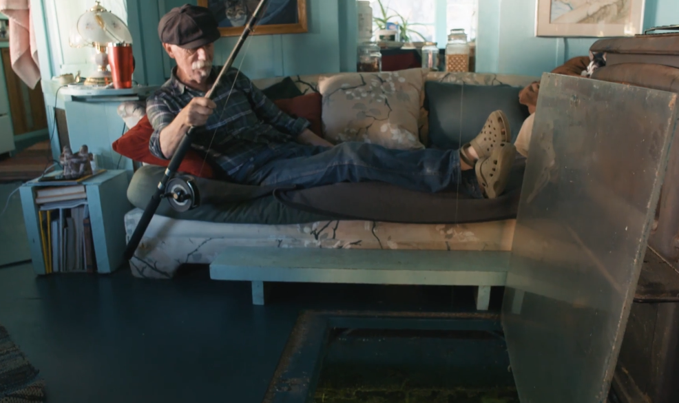 wayne fishes in living room