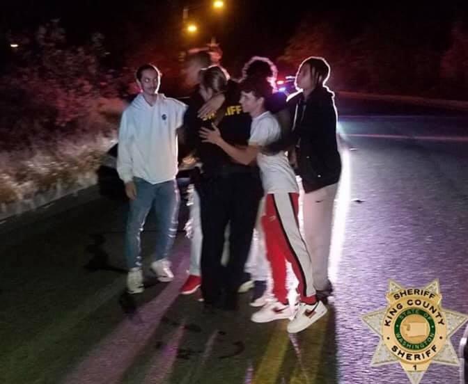 teen heroes hug deputy elliott