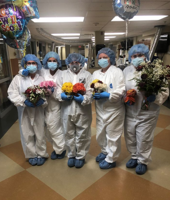 nurses hold bouquets
