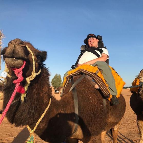 cory rides camel