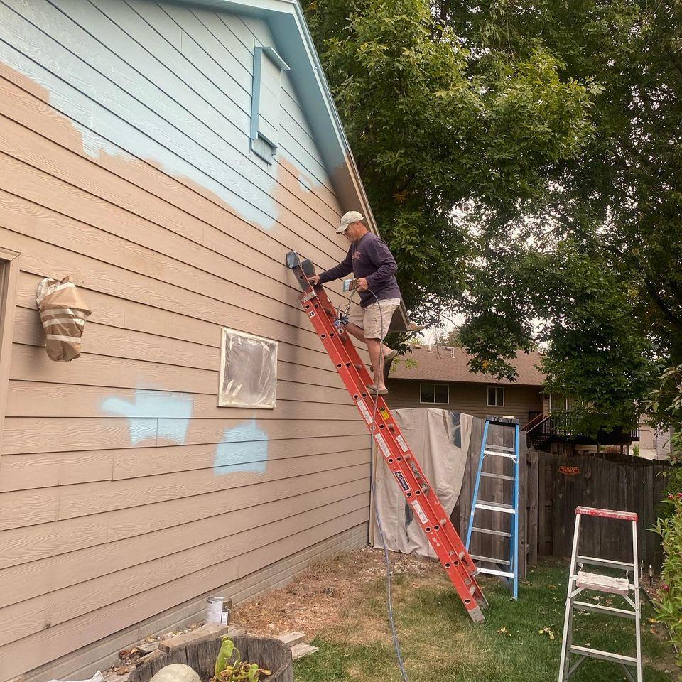 teacher paints house