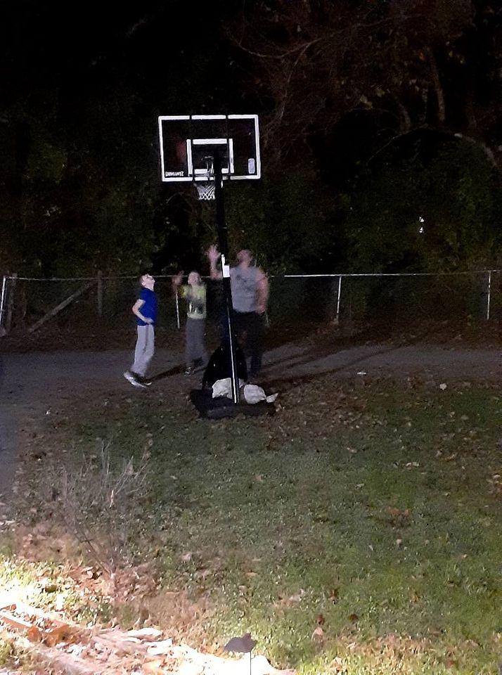 family plays basketball