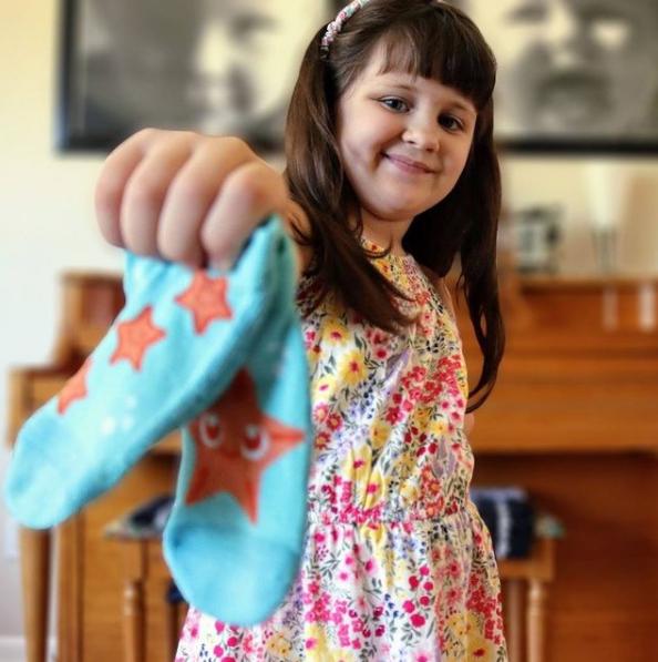 ella holds sock