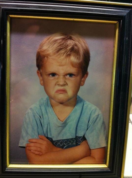 grumpy child in school portrait