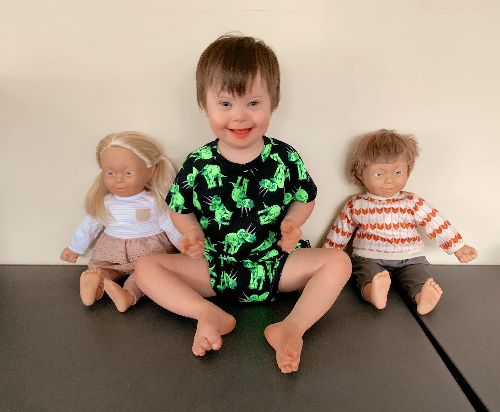 elijah with inclusive dolls
