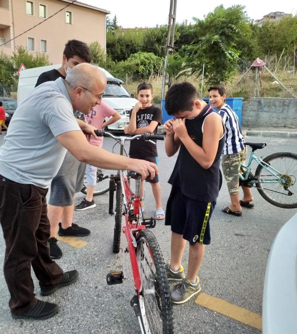 man gives bike to kid