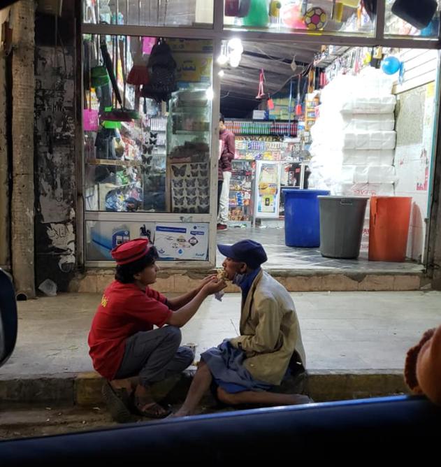 teen feeds homeless man