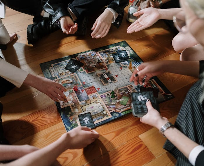 adult friends playing a board game