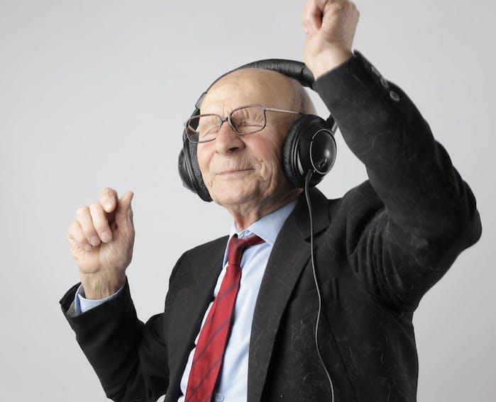 elderly man dancing with headphones on