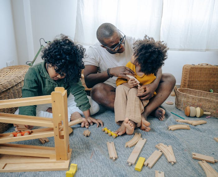 dad playing with his two kids