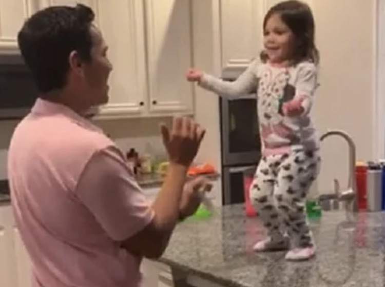 dad and daughter doing salsa