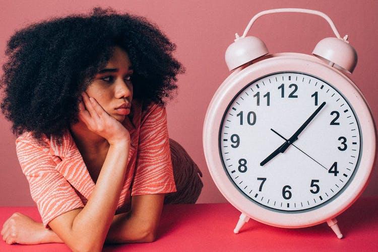 girl and alarm clock