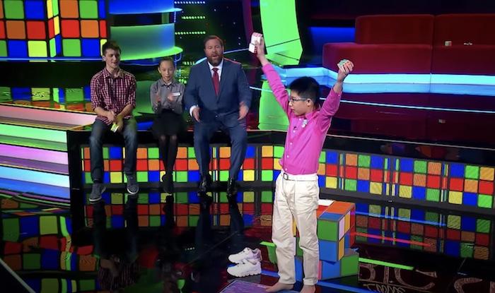 boy holding rubik's cubes