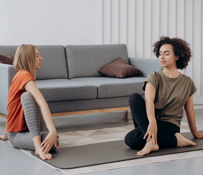 two women stretching