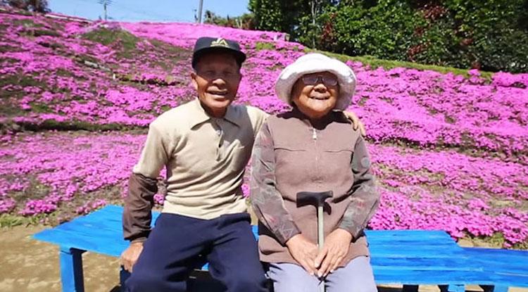 couple in garden of flowers
