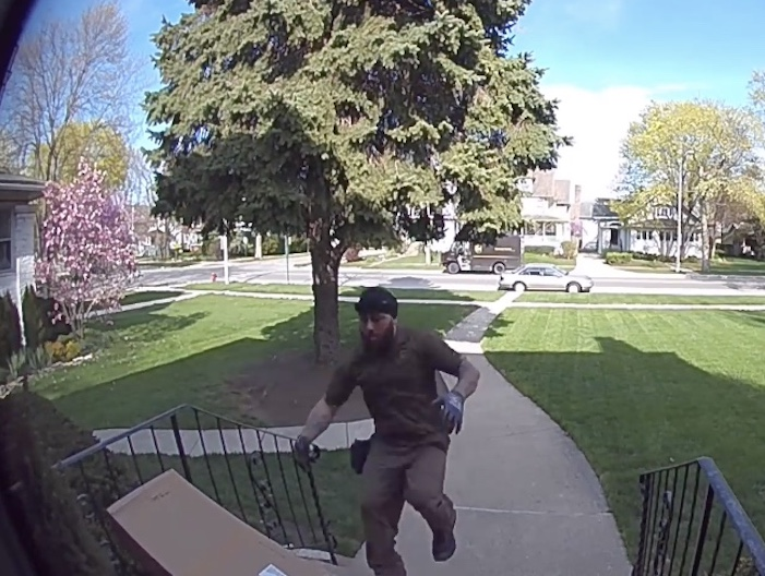 deliveryman running to save boy